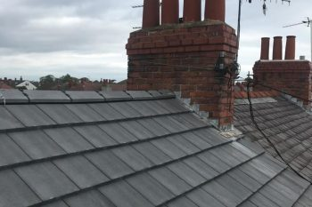 Grey Concrete tiled roof with dry ridge system - Liverpool